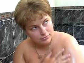 Two guys fuck fat chick in bathroom