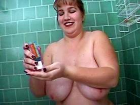 Bimbo with giant boobs solo in bath