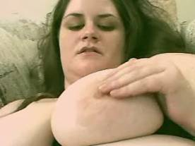 Huge busty lady playing with red dildo