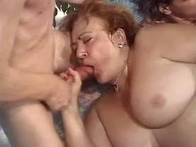 Fat mature gets facial in gangbang