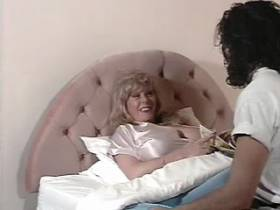 Blond busty milf seduces guy on bed