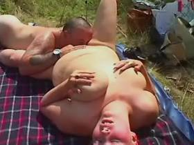 Fat busty wife makes oral on picnic