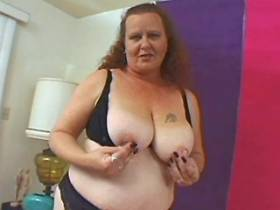 Plump busty mature dildoing herself
