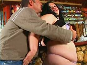 Chubby busty brunette sucks in bar