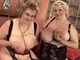 Two big ladies with huge tits have fun