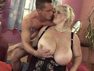 Blond milf with huge boobs seduces guy