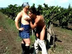 Plump mature sucks cock on vineyard