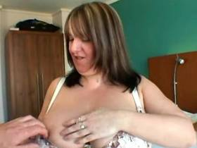 Chubby mature lady presents huge boobs