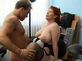 Redhead busty mature gets fucked on table