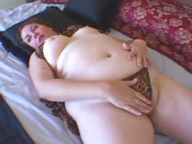 Fat slutty plays with dildo in bedroom