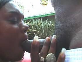 Black plumper sucks chocolate cock by pool