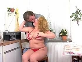 Blonde fatty greedily sucks cock